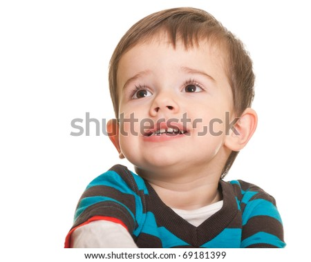 A portrait of a little boy in casual; isolated on the white background (Shallow DOF - Focus on eyes) - stock photo