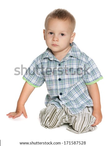A portrait of a little boy on the white background