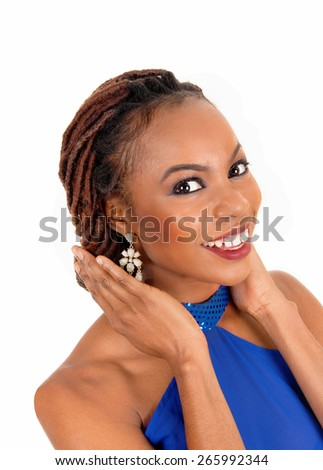 A portrait of a lovely African American woman smiling with her hands on