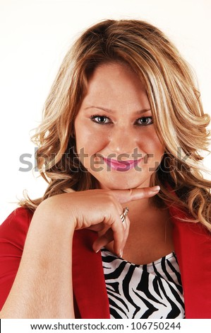 A portrait of a lovely smiling young woman with long blond hair one finger under her chin and for white background.