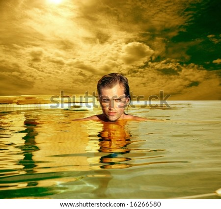 a portrait of a man in swimming pool - stock photo