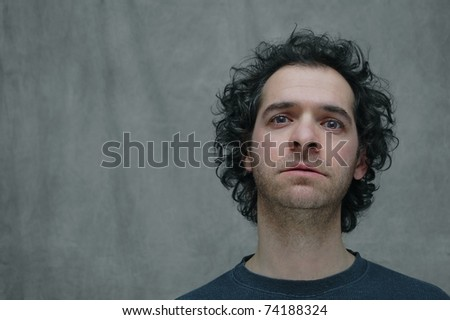 A Portrait of a Man with a Sad, Longing Expression on a Black and White Background with Room for Text - stock photo