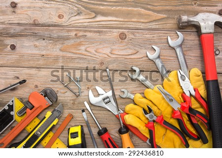 A portrait of a mechanical kit in wooden background. construction tool with a copy space