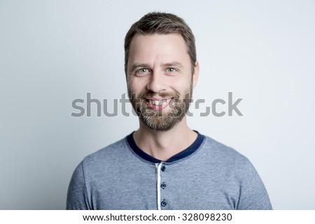 A Portrait of a men in studio gray background - stock photo