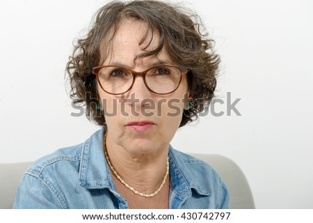 a portrait of a middle-aged woman angry