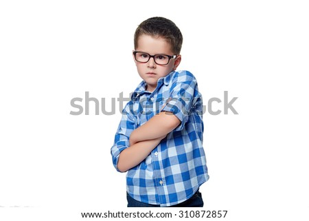 A portrait of a pensive preschool boy against the white background.