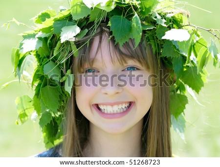 A portrait of a pretty girl wearing green wreath - stock photo