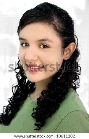 a portrait of a pretty hispanic teenage - stock photo