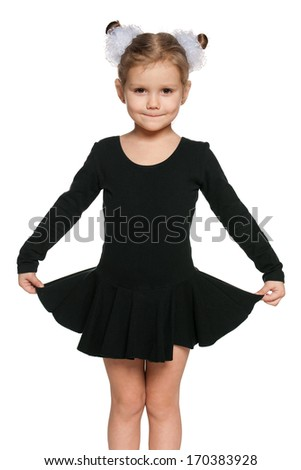 A portrait of a pretty little girl dancing on the white background - stock photo
