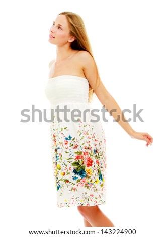 A  portrait of a pretty young girl wearing a nice summer dress, isolated on white - stock photo