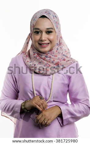 A portrait of a religious young, religious and beautiful Muslim Malaysian lady with colorful scarf used as hijab - stock photo