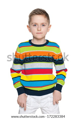 A portrait of a serious fashion young boy on the white background - stock photo