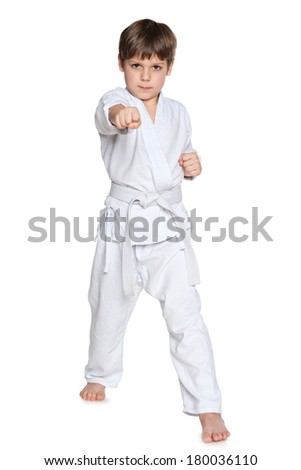 A portrait of a serious little boy in kimono on the white background