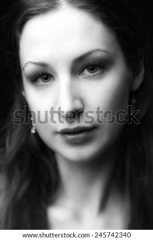 A portrait of a sexy young model with perfect skin and glamour makeup. - stock photo
