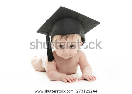A Portrait of a sitting baby with a graduation cap - stock photo