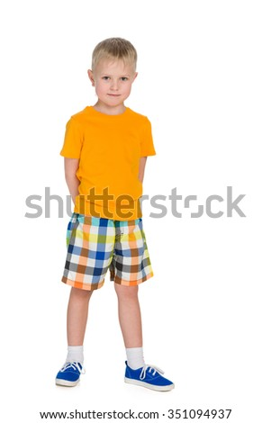 A portrait of a smiling little boy in a yellow shirt