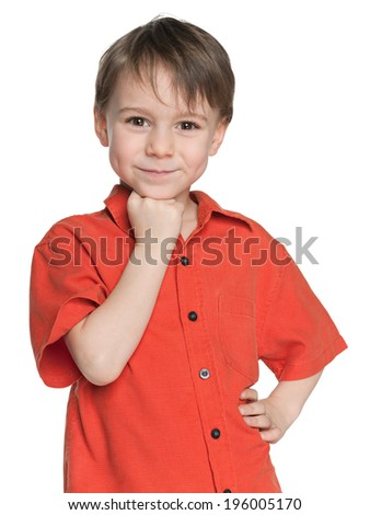 A portrait of a smiling little boy in the red shirt on the white background - stock photo
