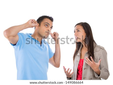 A portrait of a stressed couple going through hard times in their relationship, isolated on a white background . Young woman trying to explain something to a man , he is annoyed and closes his ears. - stock photo