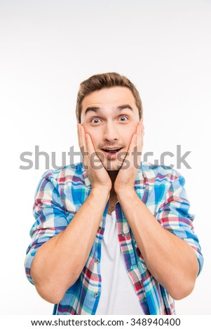 A portrait of a surprised young handsome man - stock photo