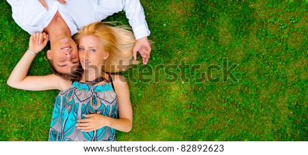 A portrait of a sweet couple in love. Photo from above. Horizontal. Blank  copyspace for your text and logo
