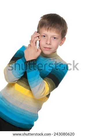 A portrait of a thoughtful boy with a cell phone on the white background - stock photo