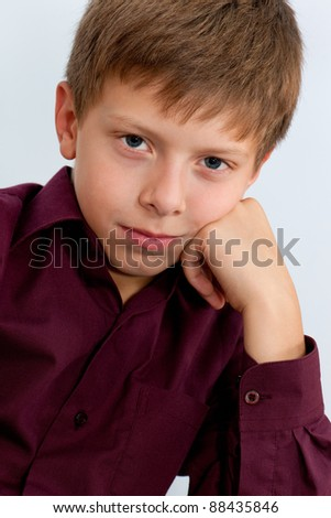 A portrait of a thoughtful handsome boy - stock photo