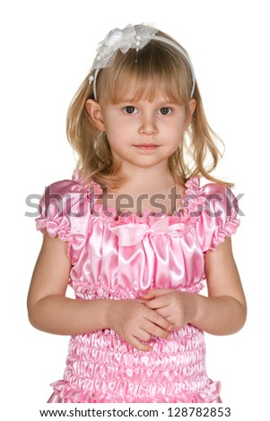 A portrait of a thoughtful little girl in pink; isolated on the white background