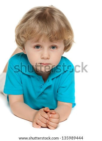 A portrait of a thoughtful preschool boy on the white background