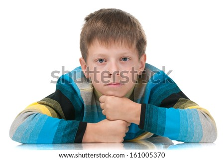 A portrait of a thoughtful young boy on the white background - stock photo