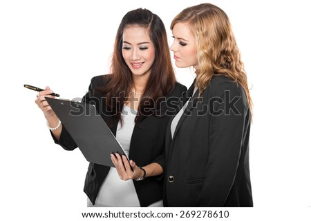 A portrait of a two young businesswoman with a clipboard, isolated - stock photo
