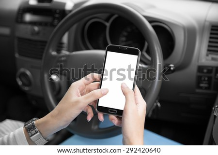 A portrait of a woman's hands using cellphone inside a car, close up - stock photo