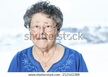 A portrait of a 90 years old senior in is apartment - stock photo