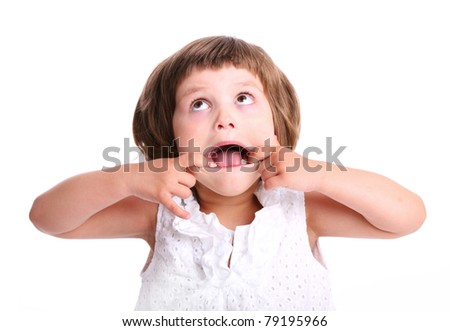 A portrait of a young adorable girl making faces over white background