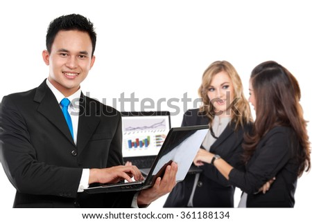 A portrait of a young asian businessman, with his staff behind. isolated in white background - stock photo
