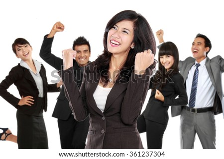 A portrait of a young asian businesswoman with her team behind, make a success gesture. isolated in white background