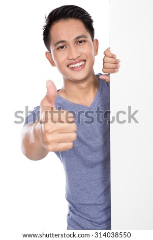 A portrait of a young asian man holding a blank banner isolated on white background - stock photo