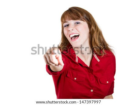A portrait of a young beautiful woman laughing and pointing at someone with her finger, Isolated on white background