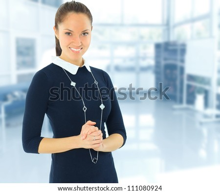 A portrait of a young business woman in an office - stock photo