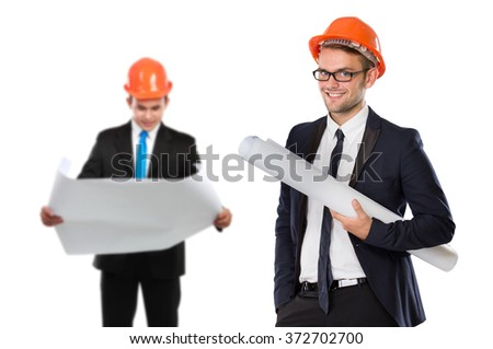 A portrait of a young businessman wear a safety helmet. his partner at the background - stock photo