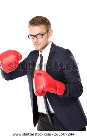 A portrait of a young businessman with boxing gloves - stock photo