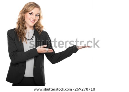 A portrait of a young businesswoman showing  copyspace, isolated on white background - stock photo