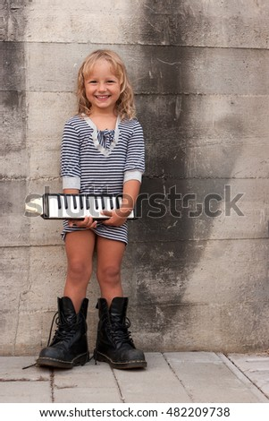 A portrait of a young girl, holding a musical instrument