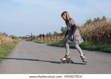 a portrait of a young girl on her inline roller skates