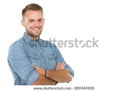 A portrait of a young man smile brightly, crossed arms, isolated - stock photo