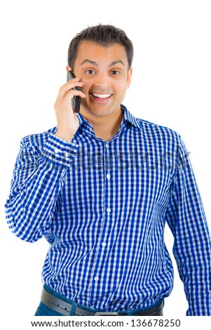 A portrait of a young man talking on a phone, isolated on white background. - stock photo