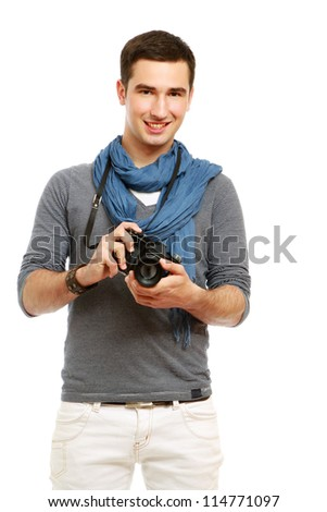 A portrait of a young photographer with a camera, isolated on white
