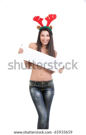 a portrait of a young woman, standing. she is dressed in blue jeans and wears red reindeer horns, holding a white plate in front of her, smiling. - stock photo