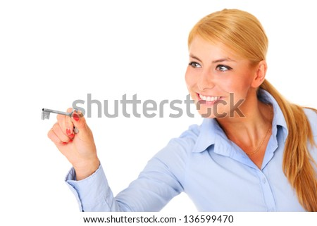 A portrait of a young woman with a key over white background - stock photo
