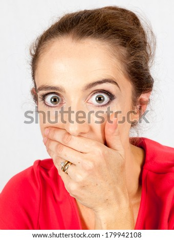 a portrait of a  young woman with a shocked response expression - stock photo