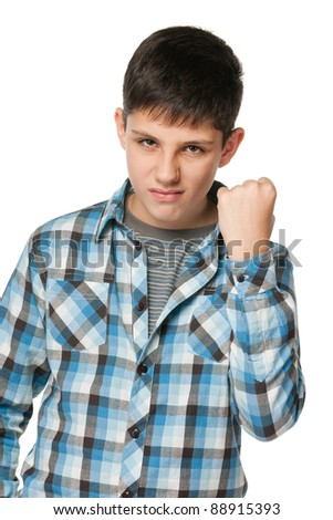A portrait of an aggressive boy; isolated on the white background